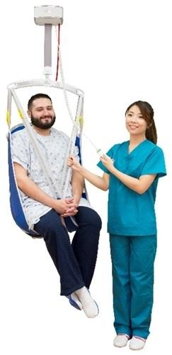 Nurse lifting patient