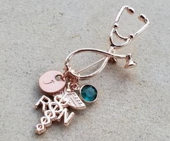 View the product Rose Gold Stethoscope Personalized Nurse Pins by Amula Designs